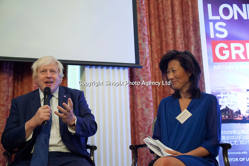 OCTOBER 15, 2015 -TOKYO, JAPAN: Mayor of London Boris Johnson MP at an event at the British Embassy in Tokyo, to encourage collaboration between London and Japan in financial technology.   Right hand side is Tech UK Chair Eileen Burbidge (Photo / Ko Sasaki)