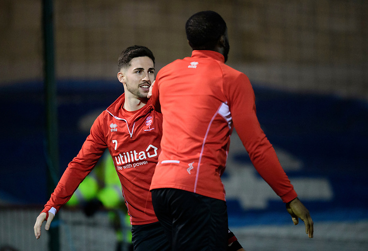 Lincoln City's Tom Pett, left, with team-mate John Akinde during the pre-match warm-up<br /> <br /> Photographer Chris Vaughan/CameraSport<br /> <br /> The EFL Sky Bet League Two - Lincoln City v Exeter City - Tuesday 26th February 2019 - Sincil Bank - Lincoln<br /> <br /> World Copyright © 2019 CameraSport. All rights reserved. 43 Linden Ave. Countesthorpe. Leicester. England. LE8 5PG - Tel: +44 (0) 116 277 4147 - admin@camerasport.com - www.camerasport.com