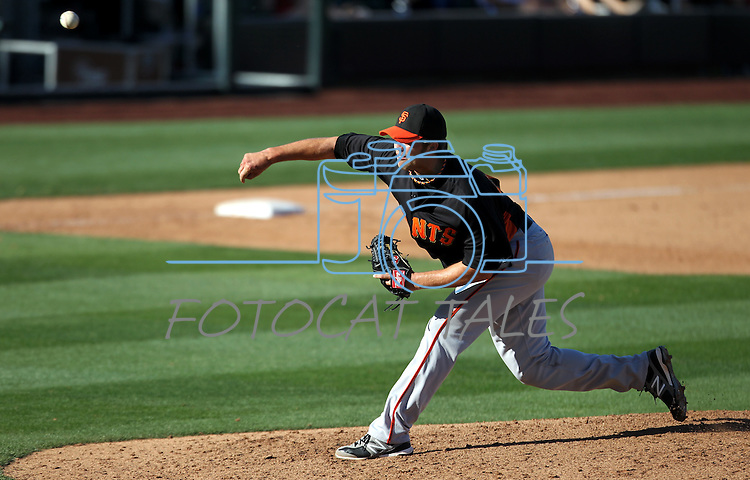 Justin Fitzgerald throws for the Giants during a Cactus League preseason game between the San Francisco Giants and the Arizona Diamondbacks in Scottsdale, Ariz., on Sunday, March 4, 2012. .Photo by Cathleen Allison