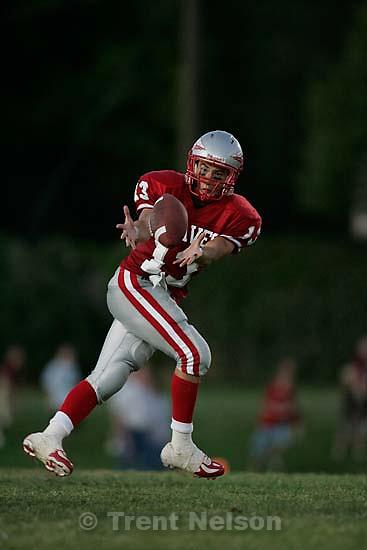 Bountiful - Bountiful's Jamie Rigby pulls in the pass. Bountiful vs. Viewmont high school football, at Bountiful.