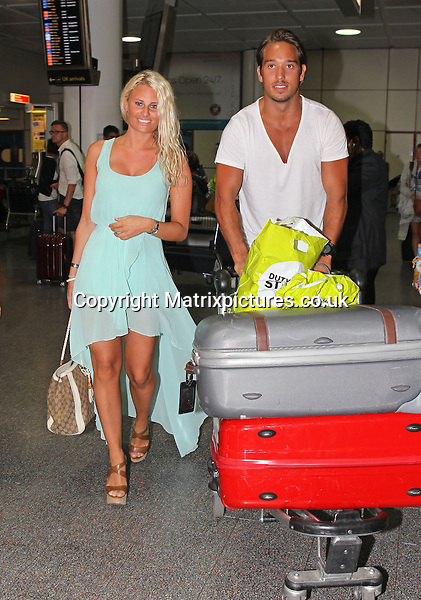EXCLUSIVE ALL ROUND PICTURE: MATRIXPICTURES.CO.UK<br /> PLEASE CREDIT ALL USES<br /> <br /> WORLD RIGHTS<br /> <br /> The Only Way Is Essex star James Lock is pictured with his girlfriend, 'Love' fashion buyer Danielle Armstrong as they arrive at London Gatwick Airport from their holiday in Turkey.<br /> <br /> SEPTEMBER 7th 2013<br /> <br /> REF: SCE 135943