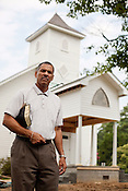 August 7, 2010. New Hill, North Carolina. . Pastor James Clanton is the head of the 1st Baptist Church of New Hill. His congregation has led the effort to get the town's African American residents involved in the fight against the proposed sewage plant.. A coalition composed of the towns of Cary, Apex, Morrisville and Holly Springs has proposed to build a waste water treatment plant in the unincorporated town of New Hill, in southern Wake County.. The residents only found out about the proposed site through a Cary resident and have been fighting the plant ever since as it brings no benefits to their town, only to the larger members of the coaltition.