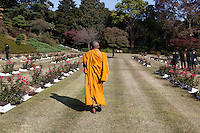 A Buddhist priest at a Ceremony for Remembrance Sunday at the Commonwealth War Graves Cemetery in Hodogaya, Yokohama, Japan. Sunday November 13th 2016. Each year representatives of the Commonwealth nations, along with American and other European nations that lost servicemen fighting the Japanese in World War 2, hold a multi-faith service of remembrance at this cemetery. This is the only cemetery for war dead in japan that is managed by the Commonwealth War Graves Commission.