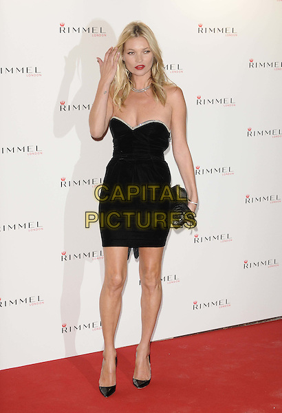 Kate Moss.attended the Rimmel London party to celebrate 10 year partnership with original London girl Kate Moss, Battersea Power Station, Kirtling Street, London, England 15th September 2011.full length black strapless dress clutch bag hand.CAP/CAN.©Can Nguyen/Capital Pictures.