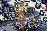 Surprise winner James Buescher (#30) celebrates in Victory Lane.