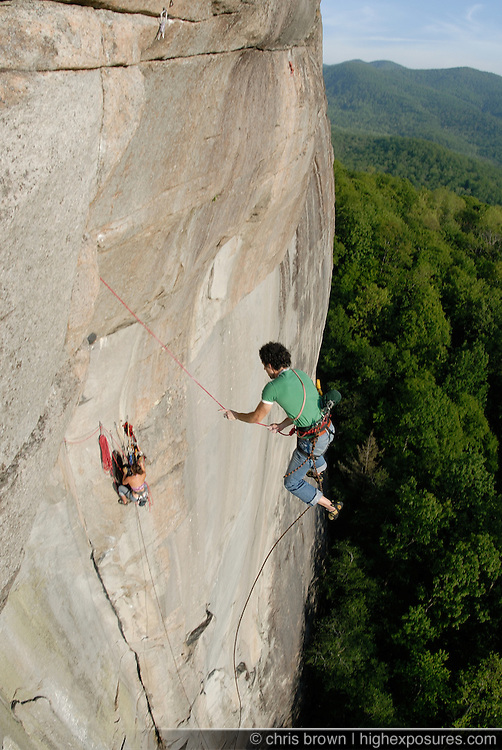 "Jen Sauer climbs the difficult rock climb ""Glass Menagerie"" on Looking Glass Rock inNorth Carolina."