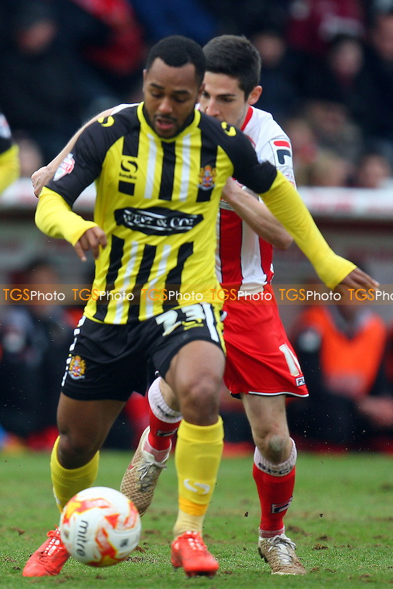 Ashley Hemmings of Dagenham and Redbridge and Tom Pett of Stevenage - Stevenage vs Dagenham and Redbridge - Sky Bet League Two football at he Lamex Stadium on 21/03/15 - MANDATORY CREDIT: Dave Simpson/TGSPHOTO - Self billing applies where appropriate - 0845 094 6026 - contact@tgsphoto.co.uk - NO UNPAID USE