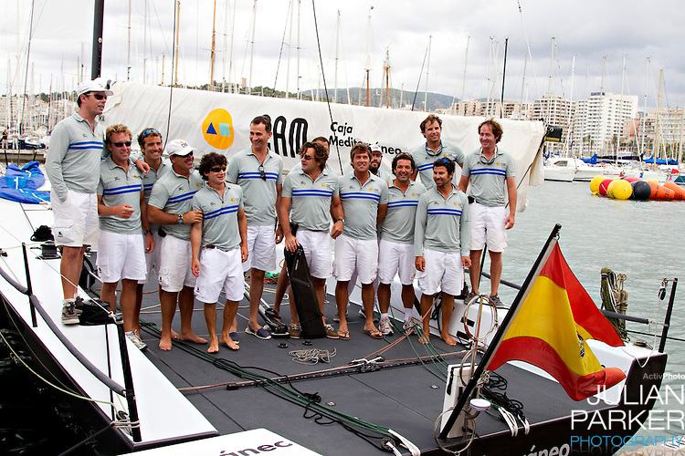 "Crown Prince Felipe of Spain, at The Royal Yacht Club, in Palma, Mallorca with the Yacht "" CAM "" and crew before competing in the third day of the Copa Del Rey sailing regatta"