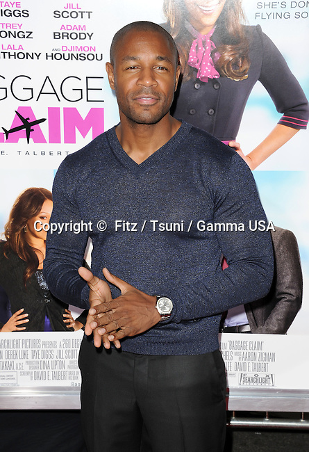 Tank  arriving at the Baggage Claim Premiere at the Regal Theatre In Los Angeles.