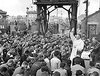 Father (Major) Edward J. Waters, Catholic Chaplain from Oswego, New York, conducts Divine Services on a pier for members of the first assault troops thrown against Hilter's forces on the continent.  Weymouth, England.  June 6, 1944.  (Army)<br /> NARA FILE #:  111-SC-190504<br /> WAR &amp; CONFLICT BOOK #:  1039