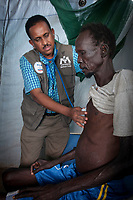 DOCTOR MERONI ABRAHAM checks on a patient being treated for Tuberculosis, chronic malaria and possible liver disease in the International Medical Corps hospital in the United Nation's Protection of Civilians camp in Juba, South Sudan. The IMC with funding from USAID, runs a clinic, emergency room, maternity ward and hospital in the camp. Abraham is the medical coordinator of the facility.