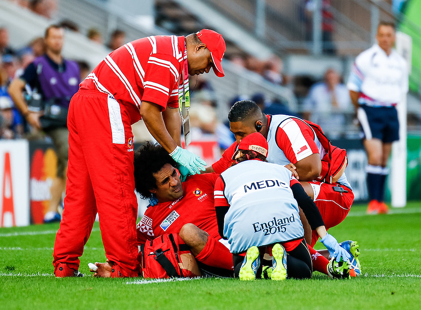 Tonga's Hale T-Pole gets some medical attention<br /> <br /> Photographer Simon King/CameraSport<br /> <br /> Rugby Union - 2015 Rugby World Cup Pool C - Namibia v Tonga - Tuesday 29th September 2015 - Sandy Park - Exeter<br /> <br /> &copy; CameraSport - 43 Linden Ave. Countesthorpe. Leicester. England. LE8 5PG - Tel: +44 (0) 116 277 4147 - admin@camerasport.com - www.camerasport.com