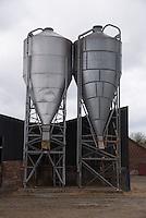 Feed bins on a dairy farm, Cheshire.