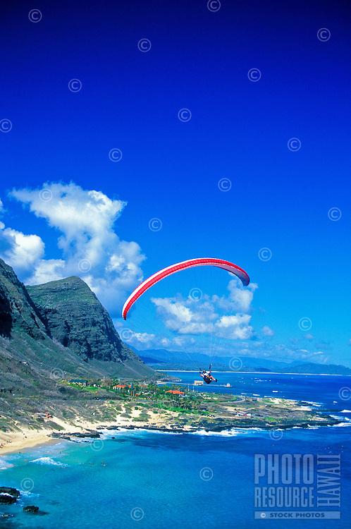 Paragliding above scenic Mokapuu Beach park,located along Oahu's windward side.