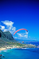 Paragliding above scenic Mokapuu Beach park,located along Oahu's windward side.