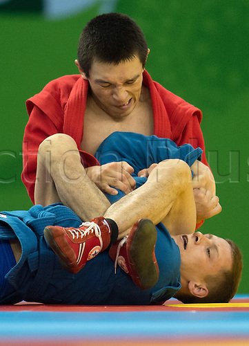 22.06.2015. Baku, Azerbaijan. 1st European Games. Aymergen Atkunov of Russia (red) fights against Uladzislau Burdz (blue) of Belarus during the Men's 57 kg semifinals competition in Sambo at the Baku 2015 European Games in Baku, Azerbaijan