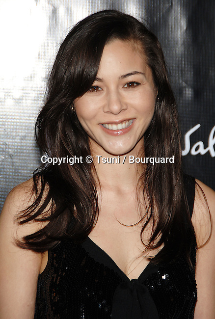 China Chow arriving at the SALVATORE FERRAGAMO RODEO WALK OF STYLE AWARDS In Los Angeles.<br /> <br /> headshot<br /> smile<br /> eye contact<br /> black dress