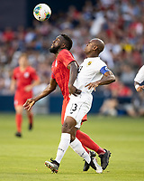 KANSAS CITY, KS - JUNE 26: Jozy Altidore #17 and Harold Cummings #3 go after the ball during a game between United States and Panama at Children's Mercy Park on June 26, 2019 in Kansas City, Kansas.