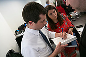 Mayor Pete Buttigieg signs a book after speaking with leaders of the Jewish community at a communal parlor meeting at the offices of Bluelight Strategies in Washington D.C., U.S. on May 23, 2019.<br /> <br /> Credit: Stefani Reynolds / CNP