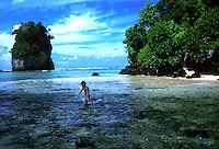 Boy wallking in the sea,  Pago Pago, American Samoa 1980