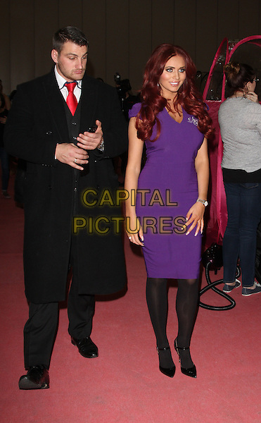 Amy Childs .appears at the Professional Beauty Show at Excel Centre, London, England..February 25th 2013.full length dress black tights purple .CAP/ROS.©Steve Ross/Capital Pictures..