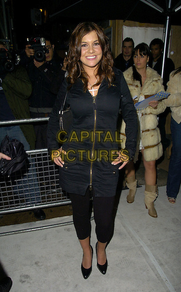 IMOGEN THOMAS.At the Jamiroquai New Album Launch Party, .Mo*vida Bar & Club, London, England, .22nd November 2006..full length big brother black coat jacket.CAN/CAP.©Can Nguyen/Capital Pictures