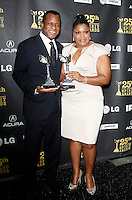 US actress Mo'nique and US actor Geoffrey Fletcher pose with their award in the press room at the 25th Independent Spirit Awards held at the Nokia Theater in Los Angeles on March 5, 2010. The Independent Spirit Awards is a celebration honoring films made by filmmakers who embody independence and originality..Photo by Nina Prommer/Milestone Photo