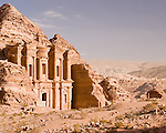 """The modern town of Wadi Musa is visible in the hills beyond Petra, overshadowed by the massive """"monestary"""" at the overlook points at the back of Petra.  © Rick Collier"""