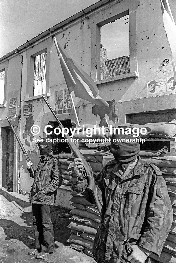 Provisional IRA members have set up a sandbag emplacement and checkpoint to regulate foot and vehicle traffic into and out of Free Derry, essentially the Bogside area of Londonderry. May 1972. 197205000294e<br />