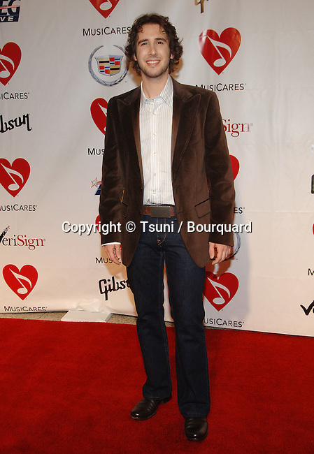 Josh Groban   arriving at the Musicare at the Staples Center In Los Angeles.<br /> <br /> full length<br /> eye contact<br /> smile
