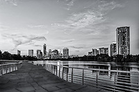 This is an image of the Austin Boardwalk in black and white. This is a popular area along the hike and bike trail with a great view of the city skyline.