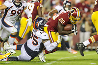 Landover, MD - August 24, 2018: Denver Broncos defensive end Derek Wolfe (95) tackles Washington Redskins running back Rob Kelley (20) during the preseason game between Denver Broncos and Washington Redskins at FedEx Field in Landover, MD.   (Photo by Elliott Brown/Media Images International)