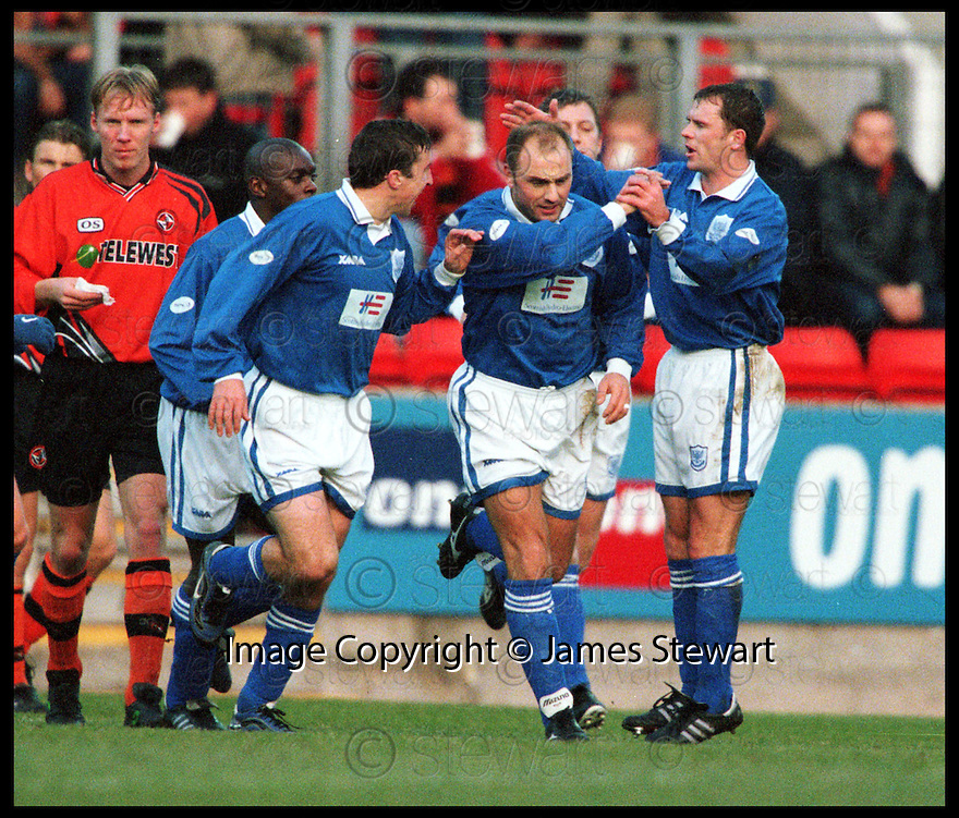 6th Feb 99        Ref : 990129 .Copyright Pic : James Stewart   .ST JOHNSTONE V DUNDEE UTD.GARY BOLLAN (2nd right) IS CONGRATULATED BY PAUL AKNE (LEFT) AND JOHN O'NEIL (RIGHT) AFTER HE FIRED HOME ST JOHNSTONES GOAL FROM THE PENALTY SPOT.......Payments to :-.James Stewart Photo Agency, Stewart House, Stewart Road, Falkirk. FK2 7AS      Vat Reg No. 607 6932 25.Office : 01324 630007        Mobile : 0421 416997.E-mail : JSpics@aol.com.If you require further information then contact Jim Stewart on any of the numbers above.........