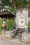 Sanur Beach, Bali, Indonesia; the ornate entrance door to the Villa Cinta from the boardwalk along the beach