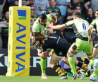 High Wycombe, England. Luther Burrell of Northampton Saints tackled by Matt Mullan of Wasps during the Aviva Premiership match between Wasps and Northampton Saints at Adams Park on September 14, 2014 in High Wycombe, England.