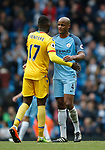 Christian Benteke of Crystal Palace and Vincent Kompany of Manchester City hug at the end of the match during the English Premier League match at the Etihad Stadium, Manchester. Picture date: May 6th 2017. Pic credit should read: Simon Bellis/Sportimage