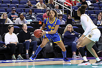 GREENSBORO, NC - MARCH 04: Emy Hayford #4 of the University of Pittsburgh looks for a teammate to pass the ball to during a game between Pitt and Notre Dame at Greensboro Coliseum on March 04, 2020 in Greensboro, North Carolina.