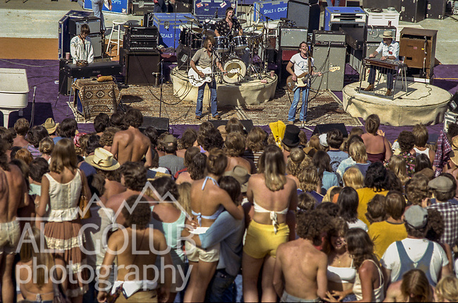Third annual Mountain Aire Renaissance Fair and Musical festival produced by Rock'n Chair Productions.  On stage are country rock band Poco on June 13, 1976 at the Calaveras County Fairground near Angle Camp California.  Photo by Al Golub