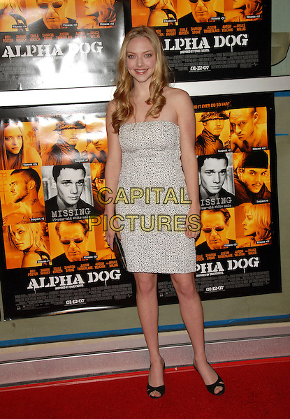 "AMANDA SEYFRIED.Universal Pictures World Premiere of ""Alpha Dog"" held at The Arclight Theatre in Hollywood, California, USA. .January 3rd, 2007.full length black white pattern strapless dress .CAP/DVS.©Debbie VanStory/Capital Pictures"