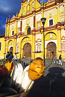 Mango and Jicama fruit being sold infront of the Catedral de la Nueva Diócesis de Chiapas which started building in 1533 and has had a number of additions and changes over the centuries up to the 19th century.  The cathedral is in the main plaza of san Cristobal de las Casas.