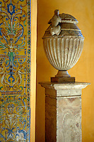 Faience tiles and a sculpted vase decorating the Patio del Crucero in the Alcazar of Seville, Seville, Andalusia, Spain.