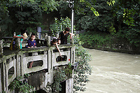 "A family visits the the Dujiangyan Irrigation System. The system is regarded as an ""ancient Chinese engineering marvel."" By naturally channeling water from the Min River during times of flood, the irrigation system served to protect the local area from flooding and provide water to the Chengdu basin. Sichuan Province. 2010"