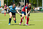 NIJMEGEN -   Marjolein de Koning (Nijm.) met Anouk Bekkers (Huizen)  tijdens  de tweede play-off wedstrijd dames, Nijmegen-Huizen (1-4), voor promotie naar de hoofdklasse.. Huizen promoveert naar de hoofdklasse.  COPYRIGHT KOEN SUYK