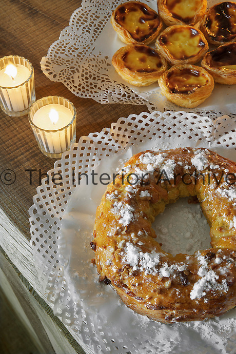 Traditional Portuguese custard tarts and a King Cake, usually eaten around Christmas, are served on paper doilies