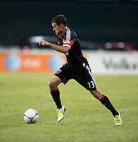 Chris Pontius (13) of D.C. United brings the ball forward during the game at RFK Stadium in Washington, DC.  D.C. United defeated the Columbus Crew, 1-0.