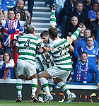 Scott Brown falls off Gary Hooper's shoulders and hits the deck