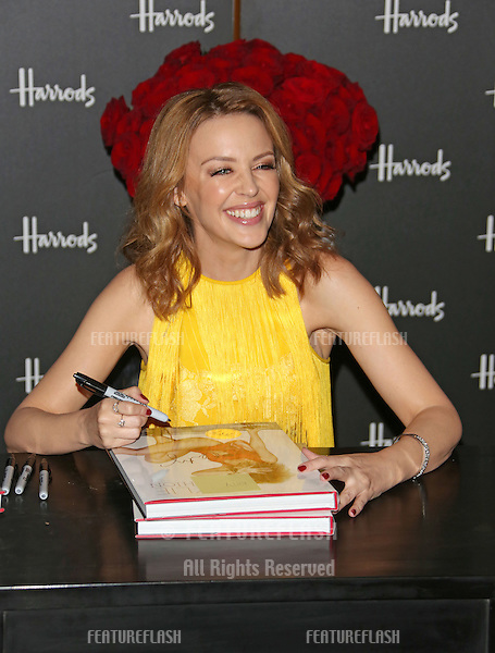 Kylie Minogue signs copies of her book Kylie/Fashion at Harrods.London, England. 28/11/2012 Picture by: Henry Harris / Featureflash