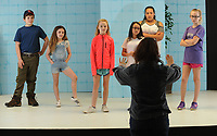 NWA Democrat-Gazette/ANDY SHUPE<br /> Instructor Jules Taylor (center) works Tuesday, March 21, 2017, with actors Vic Blasingame (from left), 12; Fiona Blasingame, 10; Viola Kelley, 10; Violet Newberry, 10; Kayla Henderson, 12; and Ayla Fortin, 11; during the Broadway Bound Theater camp at Arts Live Theater in Fayetteville. The spring break camp will culminate with a performance at the end of the week.