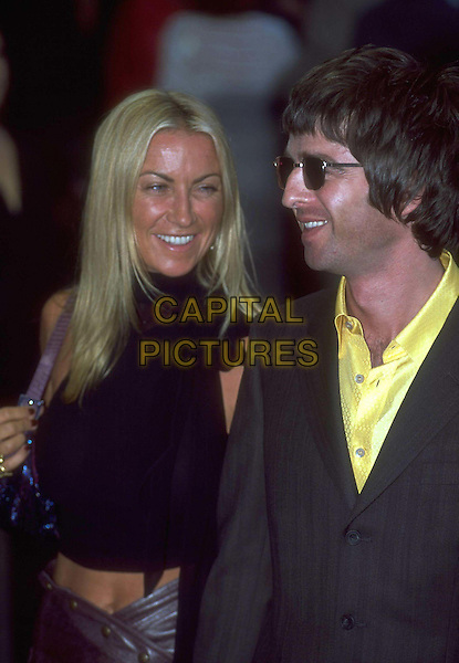 NOEL GALLAGHER & MEG MATTHEWS..Ref:9945..celeb couple, sunglasses, laughing, half length, half-length..www.capitalpictures.com..sales@capitalpictures.com..©Capital Pictures