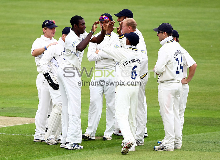 PICTURE BY VAUGHN RIDLEY/SWPIX.COM...Cricket - County Championship - Yorkshire v Warwickshire, Day 1 - Headingley, Leeds, England - 23/08/11...Warwickshire's Keith Barker celebrates the dismissal of Yorkshire's Jacques Rudolph.